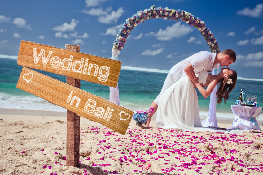 wedding couple just married near the beach at Bali with copy space for text