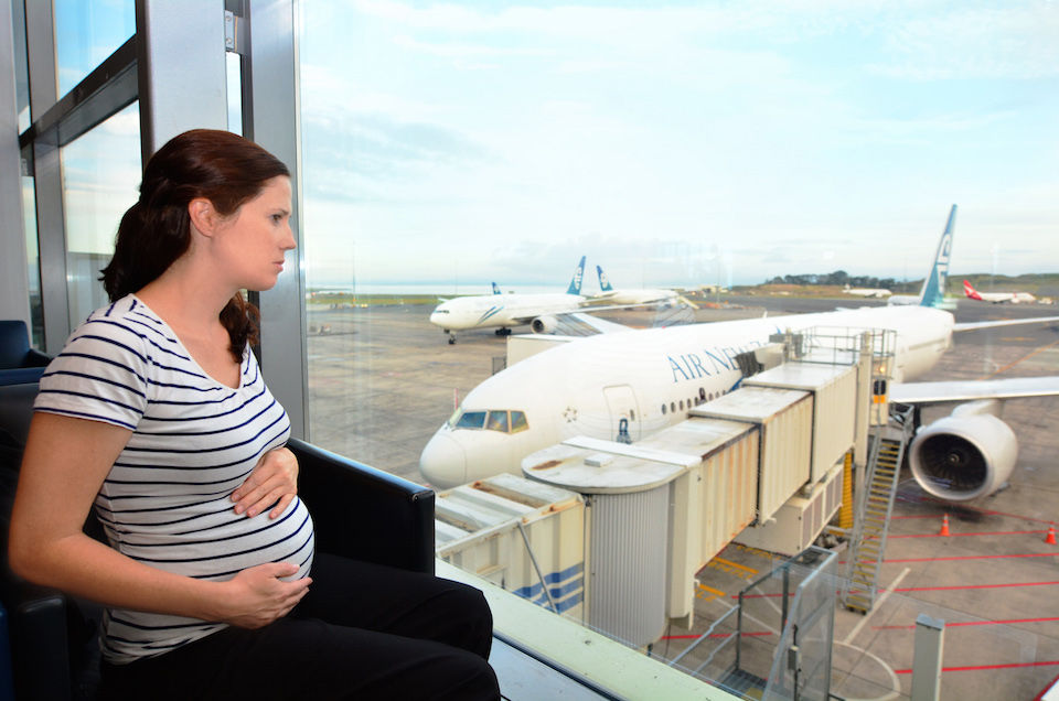 AUCKLAND - APR 10 2014:Pregnant passenger in Airport.Expectant Mothers, till the end of 35 weeks of pregnancy may be permitted to fly on Jet Airways flights provided there are no prior complications.